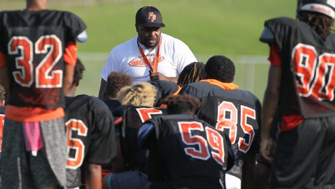 Head coach Anthony Dedmond talks to Freeport´s varsity football team on Aug. 10, 2018, at Freeport High School. Teams are now able to gather in groups of 50 or less.