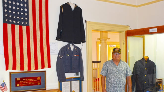 Ed Connelly is a new docent/volunteer at the Barnwell County Museum. The U.S. Army veteran is pictured with some of the museum's collection of items honoring local veterans and current military personnel.