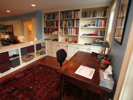Literary agent Molly Friedrich's booklined family room