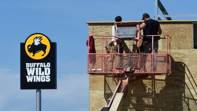 The sign for Buffalo Wild Wings Grill and Bar went up today on the new Mountain Home business. Work is progressing at the 1060 Hometown Common location in front of Lowes. It is expected to open later this year.