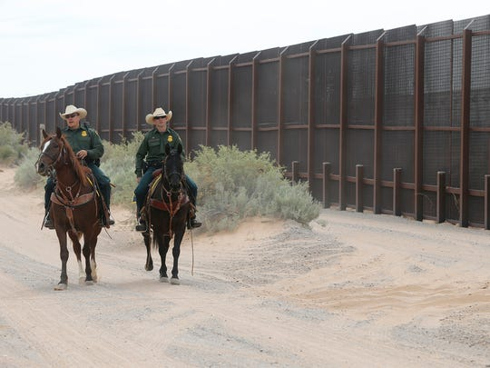 A couple of U.S. Border Patrol agents ride near the construction site of the new border wall in Santa Teresa, N.M., on Monday when officials announced the start of the 20-mile $73 million project.
