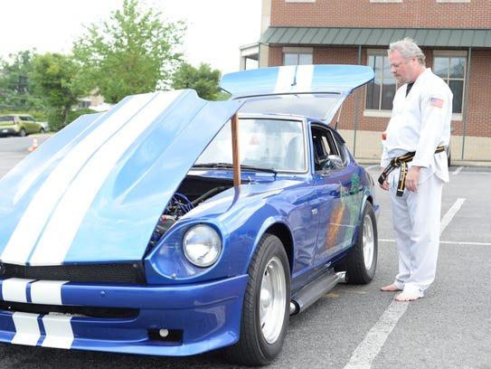 John Biggerstaff checks out a classic car during Square