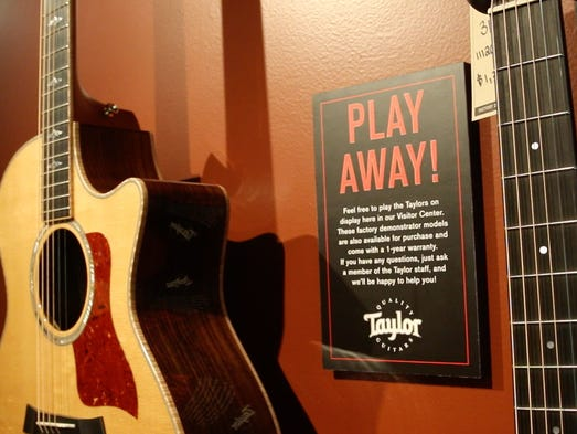 Visitors to Taylor Guitars headquarters near San Diego are encouraged to pick up instruments and strum.