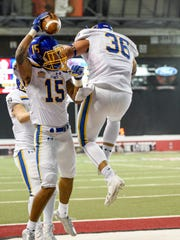 South Dakota State wide receiver Cade Johnson (15) and Luke Sellers (36) celebrate after Johnson's touchdown during the second half of their NCAA football game on Nov. 18, 2017 in Vermillion, S.D.