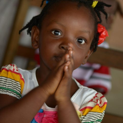 A child plays at the Restoration Baptist church in Monrovia, Liberia, on Aug. 31. Liberia said it would deny permission for any crew to disembark from ships at the country's four seaports until the Ebola epidemic was under control.
