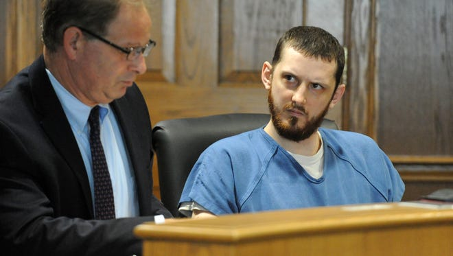 Nicholas Norton, right, looks at his attorney Thomas Elwing Wednesday, Sept. 27, 2017, in Fairfield County Common Pleas Court in Lancaster. Norton was sentenced to 4 1/2 years in prison for threatening to fire a handgun at two Fairfield County Sheriff's deputies in August 2016.