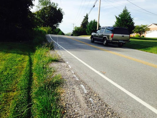 Spray-paint marks the area on N. Biesecker Road, Jackson Twp where a motorcycle rider crashed into a fence.