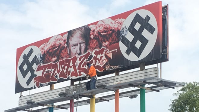 A controversial anti-Trump billboard in downtown Phoenix was vandalized with graffiti, as seen Friday, Sept. 8, 2017.