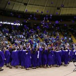 Purvis High School graduate toss their caps.