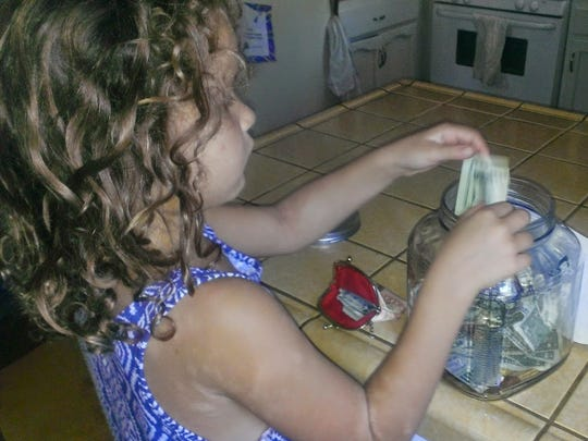 """From the Stahl's blog: """"Something so precious and powerful happened in my kitchen. My daughter came over to me and with a fierce love said, 'I will give everything I have....everything until my sister can come home!' She marched down the hall to find her change purse. She pulled every bill out one by one looked at it and put it in the donation jar. I wish I could have captured the purity of her heart and the resolve on her face as she gave everything she had. She dropped in the last dollar and turned around. She had a sweet proud look on her face for a second or two, and then just burst into tears. 'I want my sister! Why can't she be here? I don't want her to be apart from us!' She ran into my arms and I just held her as she cried. We prayed together, wiped away the tears, and counted the money. I have no idea how, but that little girl put over $60.00 in that jar!"""""""