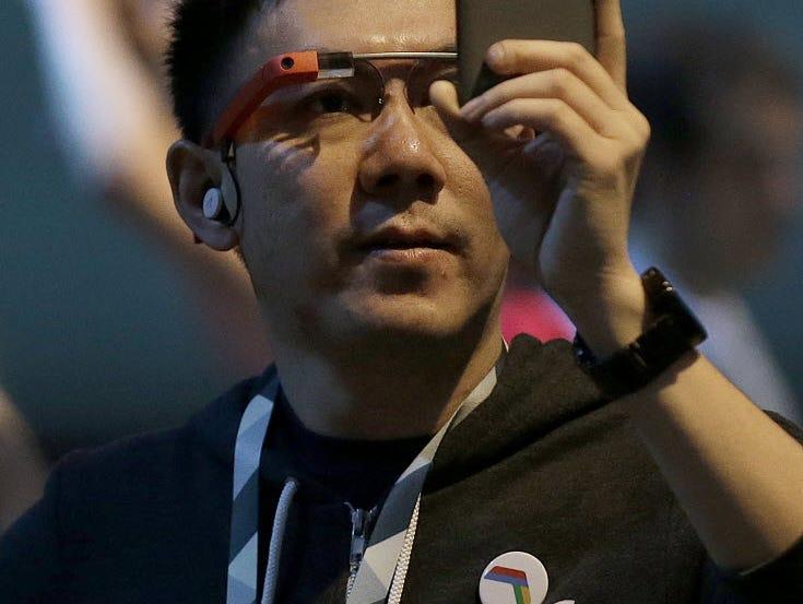 A man wearing Google Glass waits for the Google I/O 2015 keynote presentation in San Francisco, Thursday, May 28, 2015.