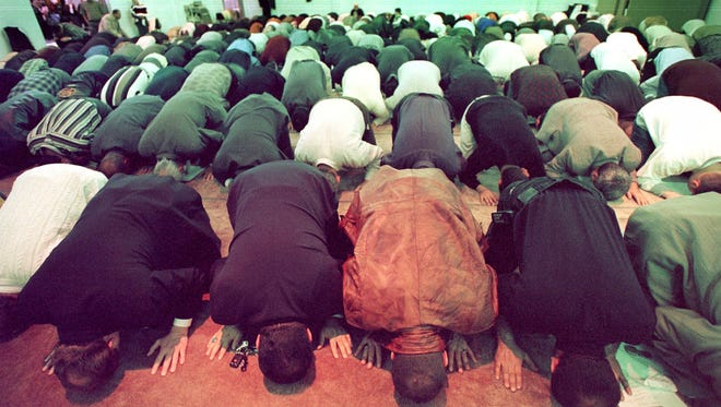 Members of the Islamic Center of America in Dearborn, Mich. pray.
