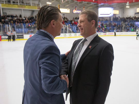 Following Saturday night's game at USA Hockey Arena, U.S. NTDP Under-18 coach Seth Appert (left) congratulates MSU head coach Danton Cole, who coached the past seven years for the NTDP,