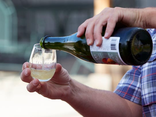 William Conkling of Ten Bears Winery pours a glass