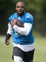 Lions running back Theo Riddick goes through drills during organized team activities Wednesday, May 31, 2017 at Allen Park.