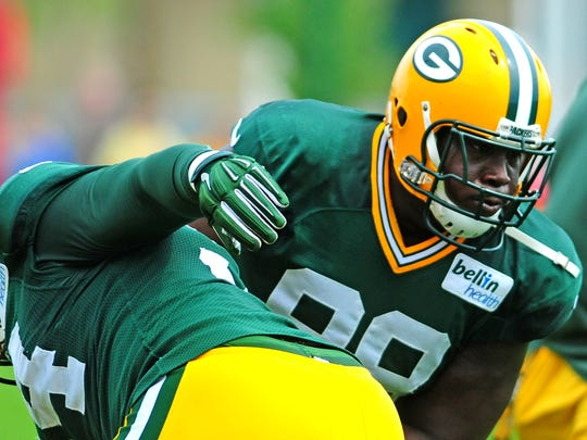 Green Bay Packers defensive tackle Letroy Guion works against defensive tackle Khyri Thornton during training camp practice at Ray Nitschke Field.