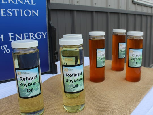 Containers of refined and crude soybean oil.