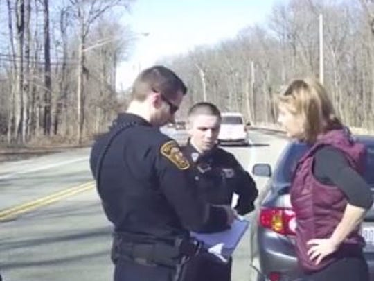 Tenafly officers converse with Caren Turner after a traffic stop in which her daughter was a passenger.
