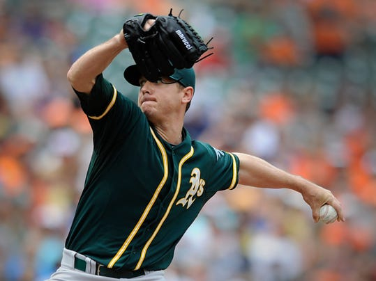 Oakland Athletics pitcher Scott Kazmir delivers against the Baltimore Orioles in the first inning of a baseball game Sunday, June 8, 2014, in Baltimore. (AP Photo/Gail Burton)