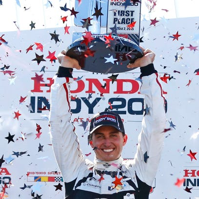 Indy Car Series driver Graham Rahal celebrates after winning the Honda Indy 200 at Mid-Ohio at Mid-Ohio Sports Car Course.
