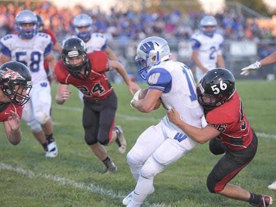 Wynford running back Zack Houck is stopped by the Bucyrus