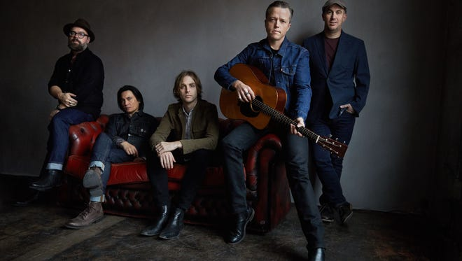 Jason Isbell (with guitar) and his band The 400 Unit play the Mempho Music Festival on Saturday.