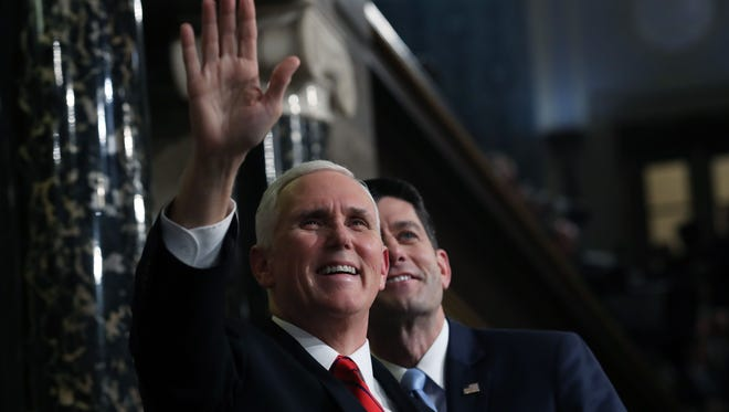 US Vice President Mike Pence (L) and Speaker of the House US Rep. Paul Ryan (R-WI) attend the State of the Union address in the chamber of the US House of Representatives in Washington, DC, on January 30, 2018. /