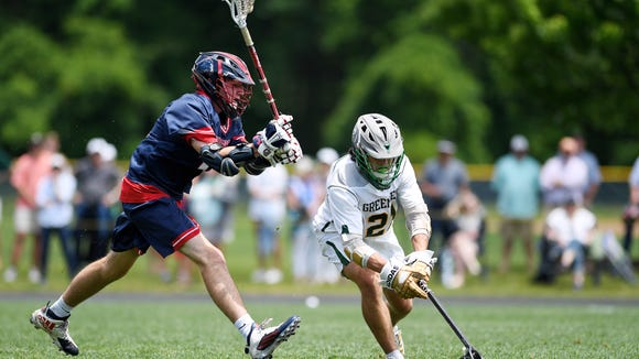 Christ School's Hunter Vines reaches for the ball as Povidence Day's Baird Cotsakis guards in the state championship in Arden May 19, 2018.