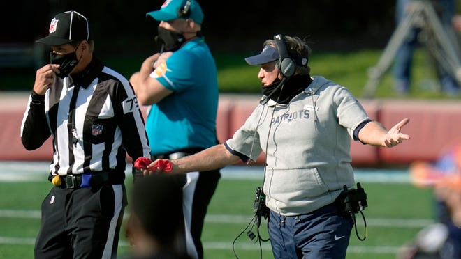 New England Patriots head coach Bill Belichick, right, appeals to down judge Kent Payne in the second half of an NFL football game against the Denver Broncos, Sunday, Oct. 18, 2020, in Foxborough, Mass.
