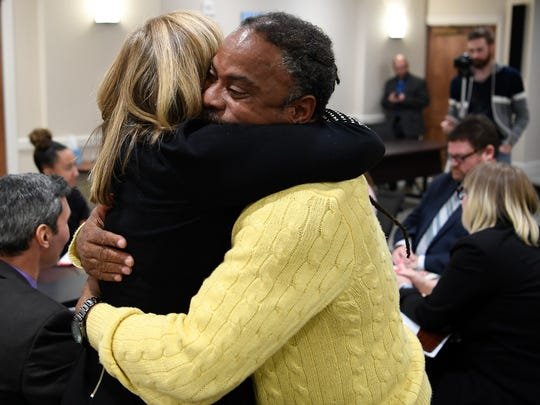 Mayor Megan Barry and Howard Allen hug during a roundtable