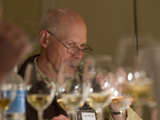 Sheldrake Point Winery partner Bob Madill judges wines during the Finger Lakes International Wine Competition in 2012.organizer of this test your knowledge Finger Lakes Wine Challenge. KRIS J. MURANTE/file photo Sheldrake Point Winery owner Bob Madill judges wines during the Finger Lakes International Wine Competition, to benefit Camp Good Days, at the Rochester Plaza hotel in Rochester Sunday afternoon, March 25, 2012.