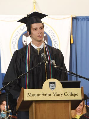 Student Government Association President and Town of Poughkeepsie resident Bradley Moody speaks at Mount Saint Mary College's 2016 commencement ceremony.