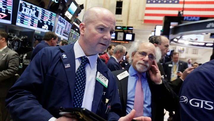 Traders Patrick Casey, left, and Peter Tuchman work