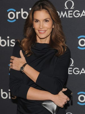 "Model, OMEGA Brand Ambassador Cindy Crawford attends the screening of ""The Hospital In The Sky"" presented by OMEGA at New York Historical Society on February 5, 2015 in New York City."