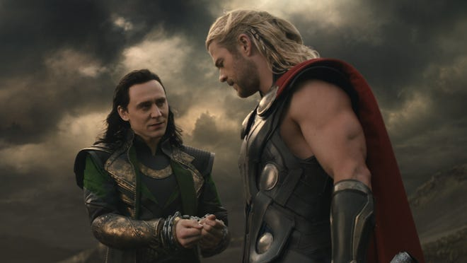 Loki (Tom Hiddleston), left, and Thor (Chris Hemsworth) join forces to confront the Dark Elf Malekith in 'Thor: The Dark World.'