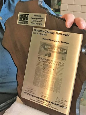 The first place award presented to Oconto County Reporter editor Kent Tempus at the awards banquet of the Wisconsin Newspaper Convention in Madison on April 13.