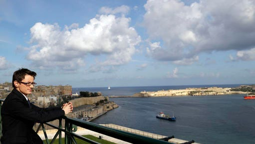 Alex Mangion looks out towards the harbor during an interview with the Associated Press, in Valletta, Wednesday, Feb. 1, 2017. Lithe and dapper in a navy-blue suit as he gazed at this capital city's storied Grand Harbor, Alex Mangion proudly described becoming Malta's first transgender politician, winning a local office on the conservative Nationalists' ticket in a country that until just a few years ago had been a last bastion in Western Europe of social norms largely dictated by the Catholic church.