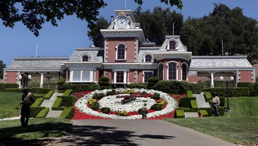 In this July 2, 2009, file photo, workers stand by at the train station at Neverland Ranch in Los Olivos, Calif. Michael Jackson's former home has been renamed Sycamore Valley Ranch.