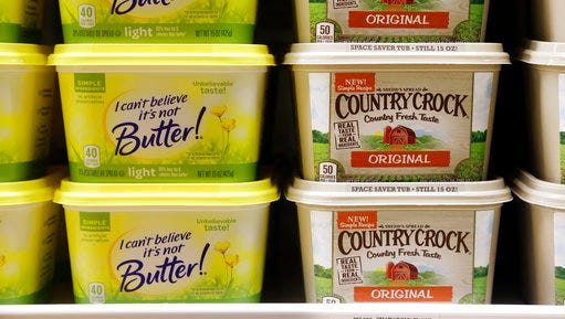 Containers of I Can't Believe It's Not Butter and Country Crock spreads sit in a grocery store cooler, Thursday, April 6, 2017, in Bellevue, Wash. Margarine's fortunes seem to be taking another sad turn, with the owner of the products looking for someone to take the brands off its hands. Consumer products heavyweight Unilever said it's seeking to unload its spreads business that has suffered from soft sales in the United States and other developed markets.