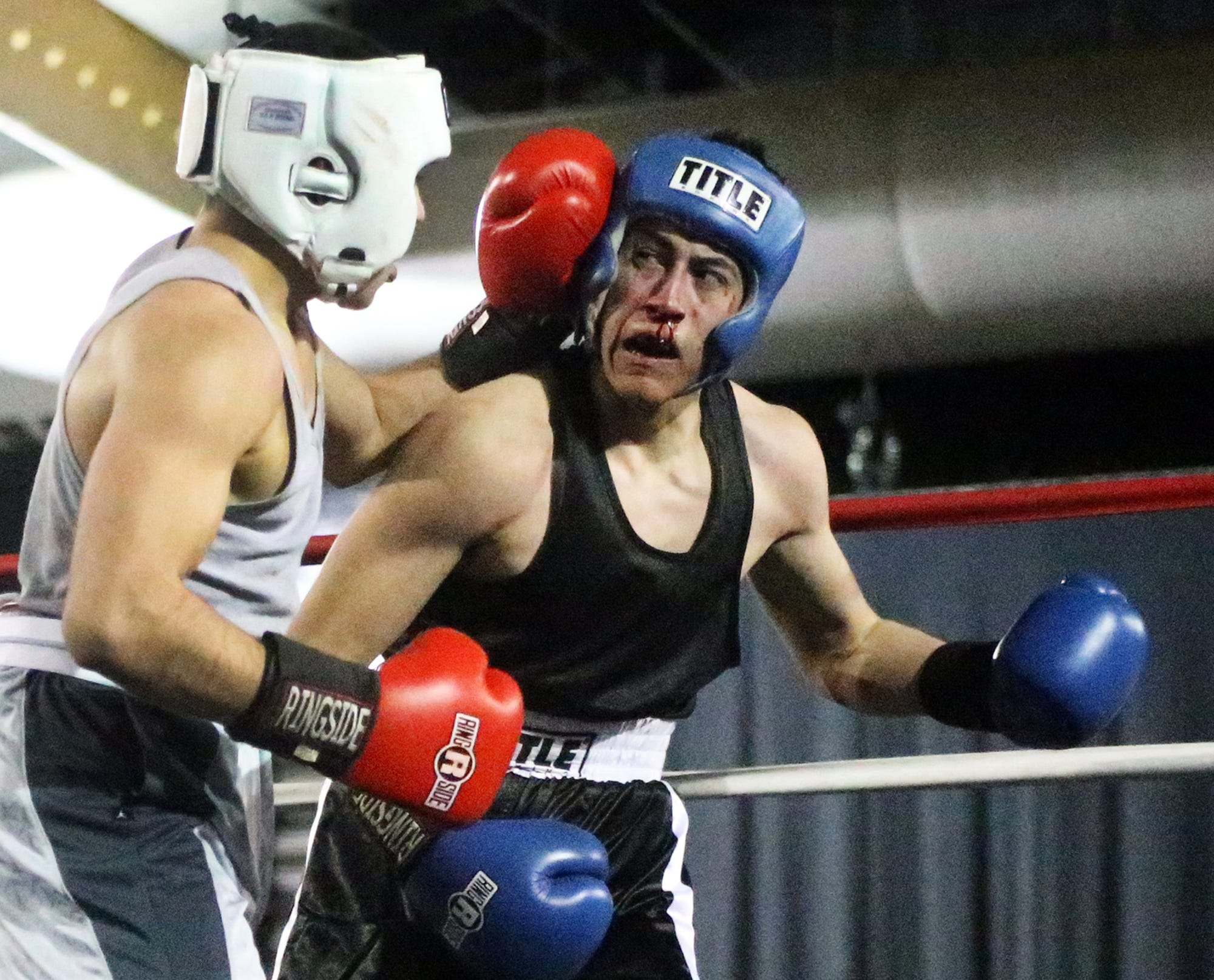 Boxer pounded by coach