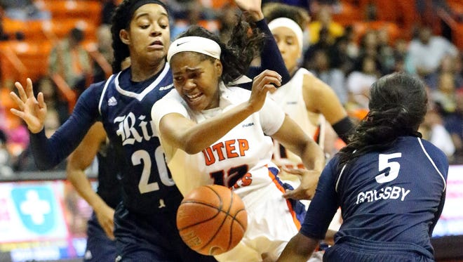UTEP's Sparkle Taylor gets the ball stripped away by Laruen Grigsby, 5, on her way to the basket, drawing a foul Saturday in the Don Haskins Center.
