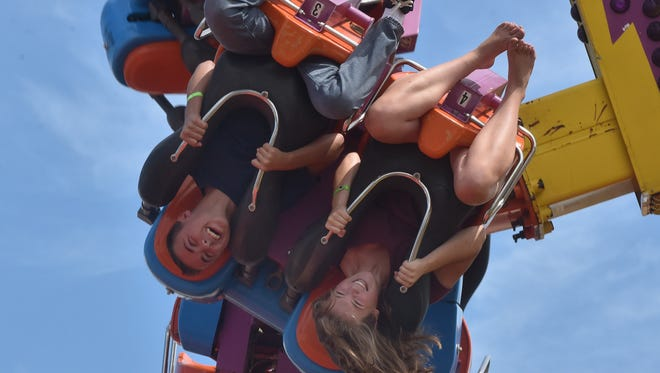 Reece Robillard and Kaitlyn Melville, both of Gardner, get flung upside down on an amusement ride on Aug. 7, 2016, at the Door County Fair. The 2017 fair gets underway today at John Miles Fair Park in Sturgeon Bay.