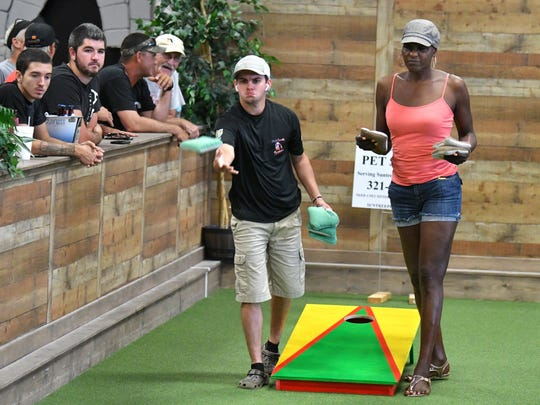 World ranked Ashton Speas of Auburndale, Fl., competing against Brenda Kelley, of Cocoa.The Backyard in Palm Shores, north of Melbourne, hosts their first annual Cornhole Tournaments July 21, 22. About 30 teams competed on Saturday.