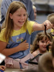 Holding millipedes is one of the hands-on experiences
