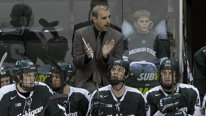 Michigan State head coach Tom Anastos cheers on his players during the first period of an NCAA Big Ten college hockey game against Ohio State in St. Paul, Minn., Thursday, March 20, 2014. (AP Photo/Ann Heisenfelt)