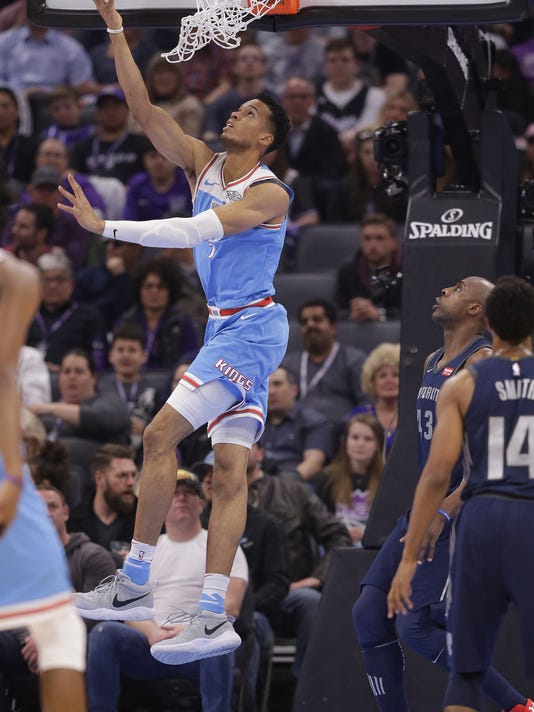 Sacramento Kings forward Skal Labissiere, left, goes to the basket as Detroit Pistons forward Anthony Tolliver, center and Ish Smith, right, look on during the first half of an NBA basketball game Monday, March 19, 2018, in Sacramento, Calif. (AP Photo/Rich Pedroncelli)
