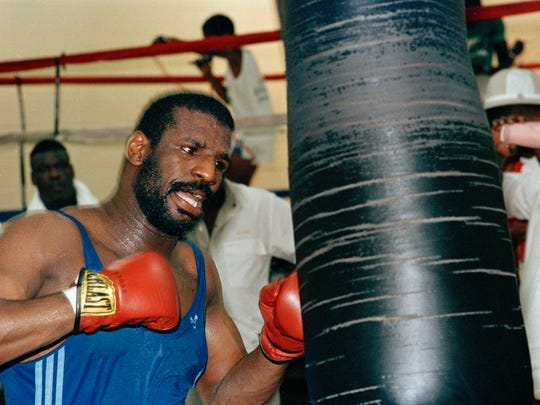 Heavyweight boxer Michael Spinks pounds on the heavy bag during a workout in Pleasantville, N.J., June 23, 1988, prior to his bout with Mike Tyson. (AP Photo/Michael Baytoff)