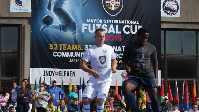 Fans cheered on teams representing the United States and Bosnia-Herzegovina during the inaugural Mayor's International Futsal Cup on Sunday, Sept. 20, 2015, at Pan Am Plaza in Downtown Indianapolis.