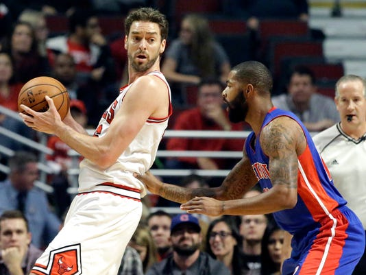 Chicago Bulls forward/center Pau Gasol, left, looks to a pass as Detroit Pistons forward Marcus Morris guards during the first half of an NBA preseason basketball game on Wednesday, Oct. 14, 2015, in Chicago. (AP Photo/Nam Y. Huh)