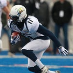 Akron edges Utah State in Boise for first bowl victory